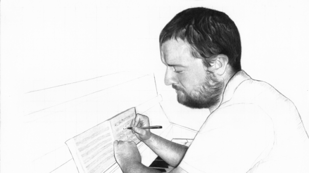 Image of Ben Gaunt writing on manuscript paper