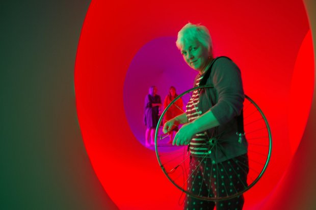 Sylvia Hallet playing a bicycle wheel