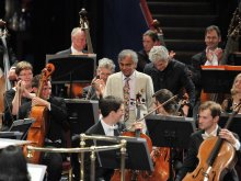Naresh with Peter Oundjian, conductor, and the RSNO at the Proms premiere of 'The Cosmic Dance'.